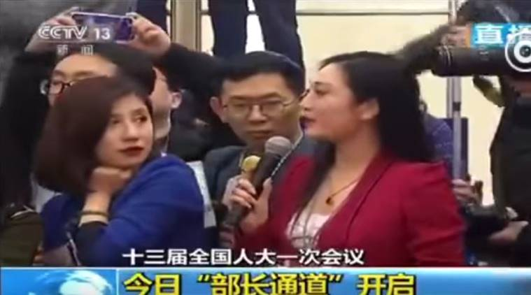 chinese reporter eye roll, epic eye roll given by Chinese reporter, epic eye roll given by Chinese reporter in blue blazer