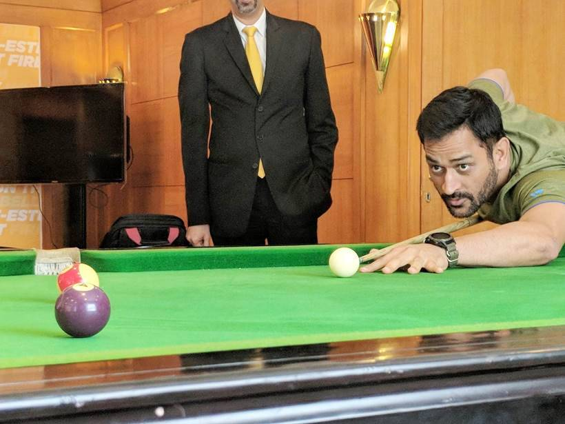 MS Dhoni playing a game of pool at CSK camp.