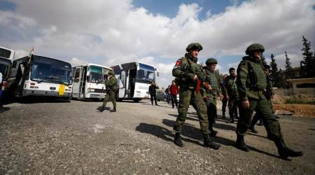 Russian military says helps evacuate 13 civilians from Syria's Ghouta