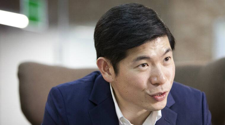 Grab buys Uber, ride-hailing services, South East Asian taxi market, SoftBank investments, Go-Jek, Anthony Tan, Uber market exits