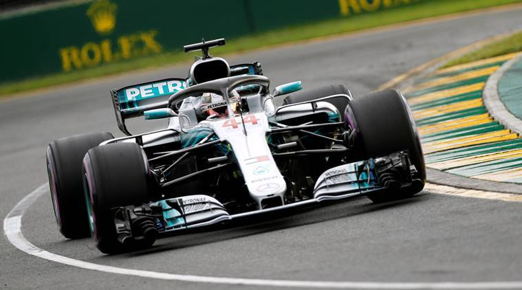 Lewis Hamilton sets lap record to take pole position in Melbourne