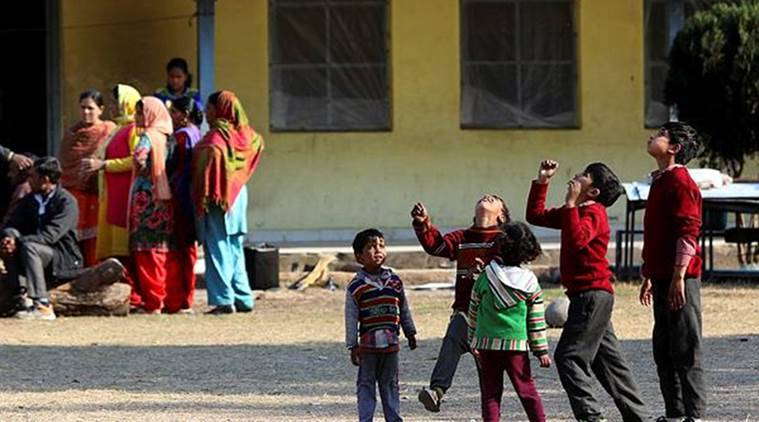 Children take shelter in a migrant camp due to heavy shelling by Pakistan at India-Pakistan LoC border in Nowshera. (Express photo)