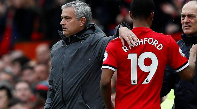 Manchester United manager Jose Mourinho with Marcus Rashford during Liverpool clash