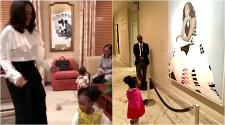 Video: Michelle Obama dances with 2-yr-old girl who was mesmerised with herportrait