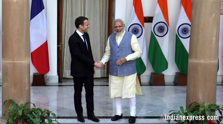 Prime Minister Narendra Modi shakes hands with French President Emmanuel Macron before their meeting at Hyderabad House in New Delhi on Saturday. (Express photo/Amit Mehra)