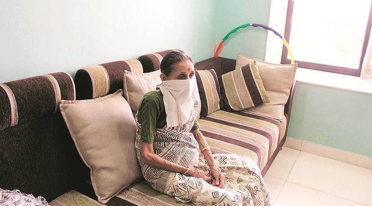 woman covers her mouth to prevent herself from inhaling toxic gas