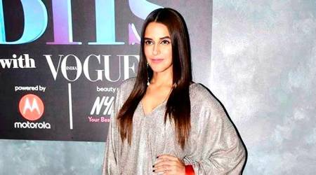 Neha Dhupia makes for a pretty picture in a ballroom gown on this magazine cover; see pics