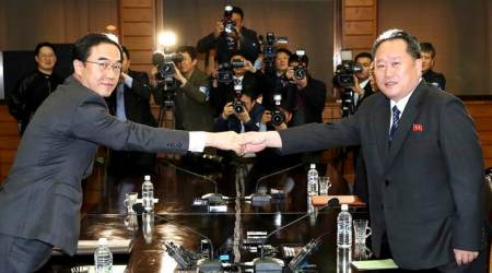 Rival North, South Korea begin high-level talks meant to set up summit