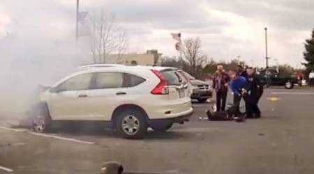 WATCH: People come together to save a man trapped inside a car on fire