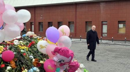 Russia's Vladimir Putin visits scene of deadly shopping mall fire