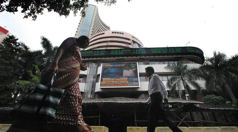 The NSE index Nifty was trading lower by 21.85 points, or 0.21 per cent, at 10,450.65 after shuttling between 10,524.60 and 10,432.