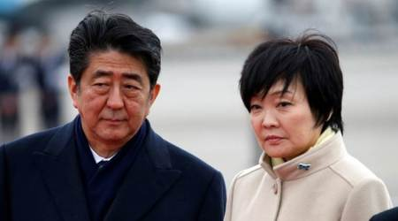 Japan PM Shinzo Abe takes blame for loss of trust over scandal as polls dive, deniesinvolvement