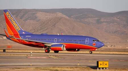 Southwest passengers leap from wing after emergency landing