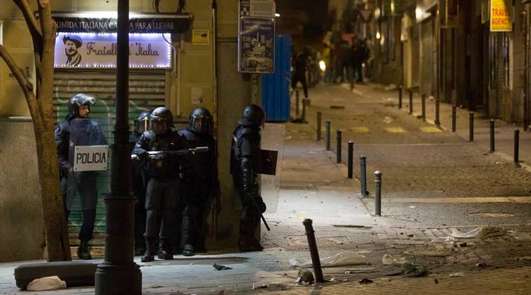 Migrants clash with riot police after death of street vendor in Madrid