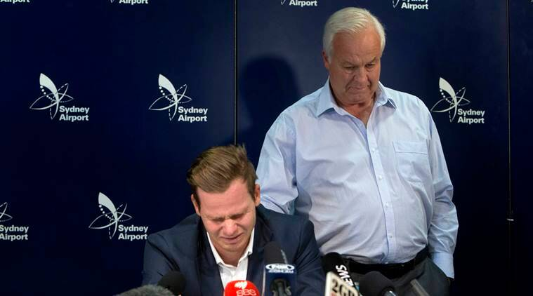 Former Australian cricket captain Steve Smith speaks to the media while being supported by his father, Peter, in Sydney
