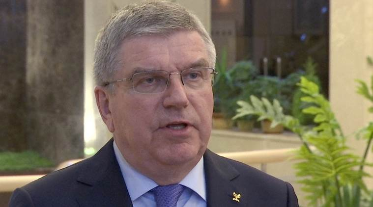 IOC chief says Kim committed to Olympics in Tokyo, Beijing