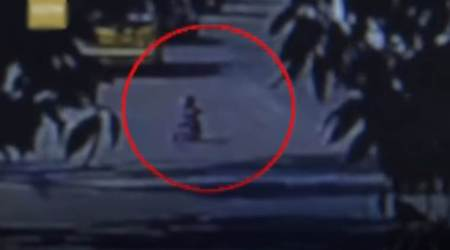 VIDEO: Toddler rides tricycle in a busy road, ESCAPES unhurt due to timely intervention