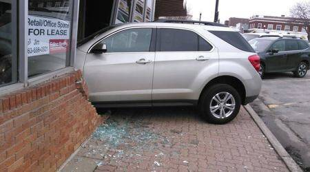 Epic EXAM fail! Teen crashes car into exam centre wall during driving test