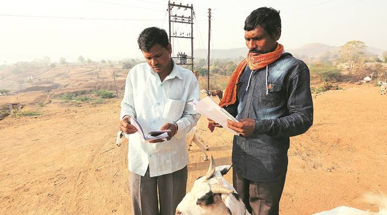 Kisan Valvi (in white) applied for labour under MNREGA last year. Till now, he has not received any work. (Prashant Nadkar)