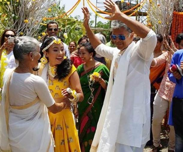 milind soman and ankita konwar during a wedding ceremony