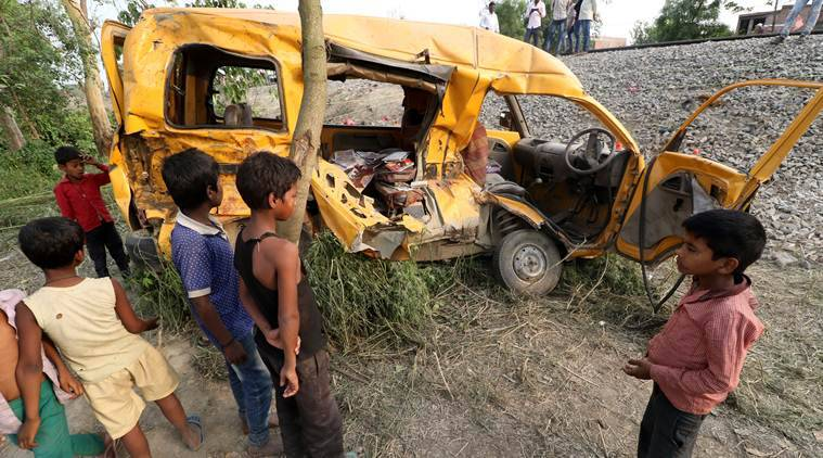 Thirteen children killed as train hits van