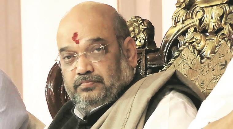 amit shah, karnataka congress, Amit Shah pays Rs 5 lakh, RSS worker, Election Commission, karnataka assembly elections 2018, model code of conduct