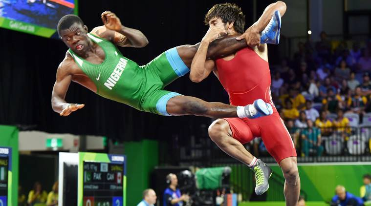 Bajrang Punia decimating Nigeria's Daniel Amas in the quarterfinals. Later he hammered Welshman Kane Charig 10-0 to win gold in the 65kg