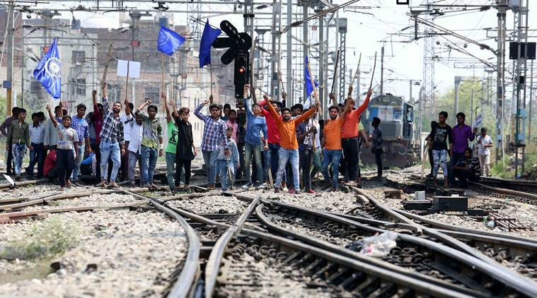 Dalit activists protest on the railway tracks in Ludhiana on Monday. (Express photo/Gurmeet Singh)