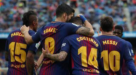 Record-breaking Barcelona back on track after beating Valencia 2-1