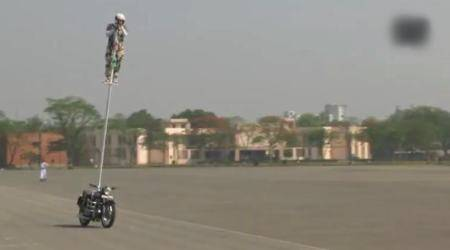 VIDEO: This BSF personnel riding a bike – STANDING on a pole – for a world record is everything awesome!