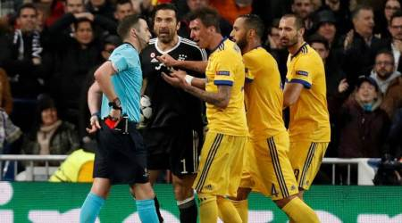 UEFA condemns online abuse of referee Michael Oliver and his wife