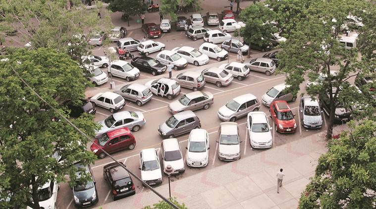 parking fees, multi level parking in delhi, sdmc, gk, lajpat nagar, delhi parking rates, indian express