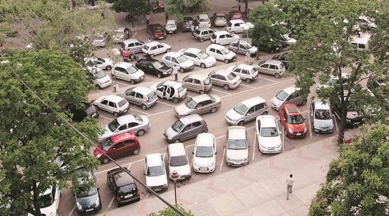 parking fees, multi level parking in delhi, sdmc, gk, lajpat nagar, delhi parking rates, indian express