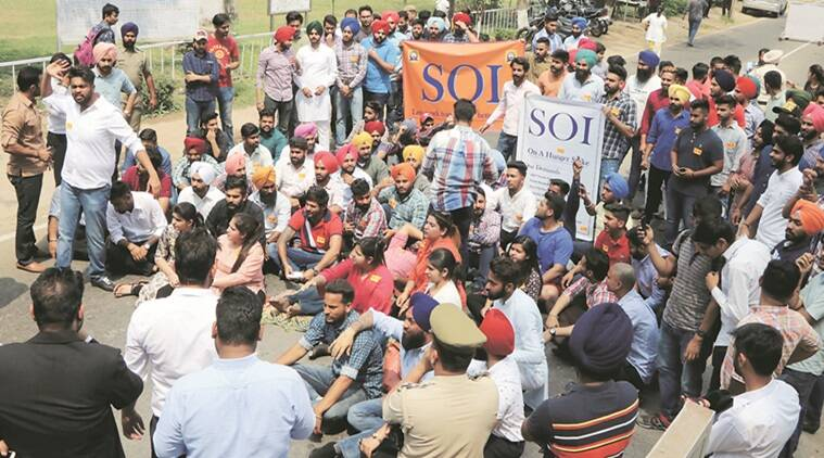 Members of SOI protest near Gate Number 3 at Panjab Univesity on Thurday. (Kamleshwar Singh)