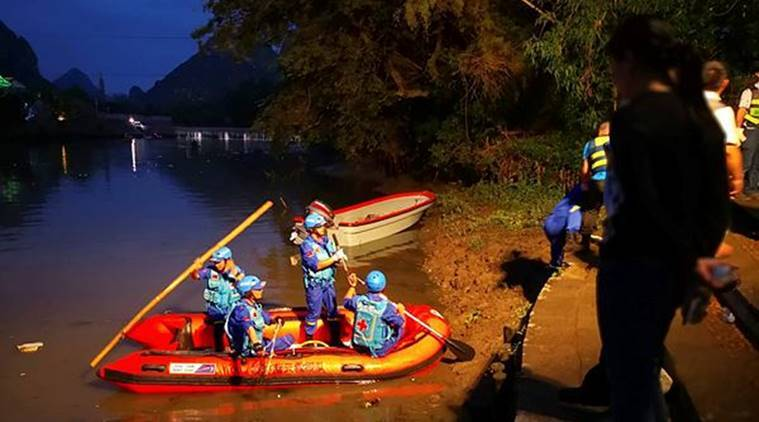 Rescuers prepare to search for missing boaters on the Taohua River in Guilin in southern China's Guangxi Zhuang Autonomous Region on Saturday. (AP)