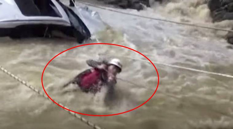 a woman stuck in flooded river, woman stuck in river in china, accident video, china viral video