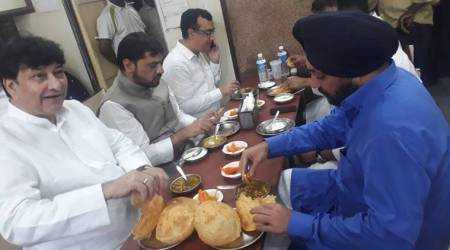 Congress leaders seen eating 'chole bhature' before hunger strike, BJP calls protest a 'farce'