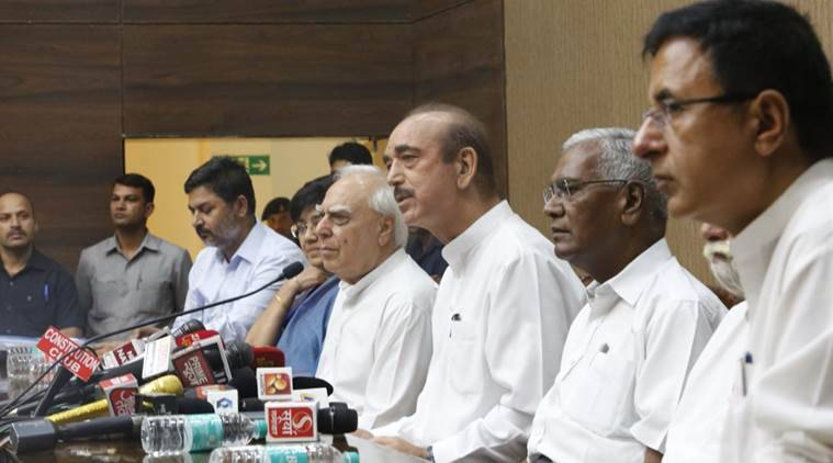 Congress leaders Ghulam Nabi Azad and Kapil Sibal address the media on Friday. (Express photo/Arun Sharma)