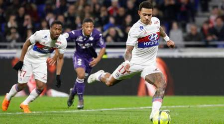 Lyon beat Toulouse 2-0 to keep up with third-place Marseille
