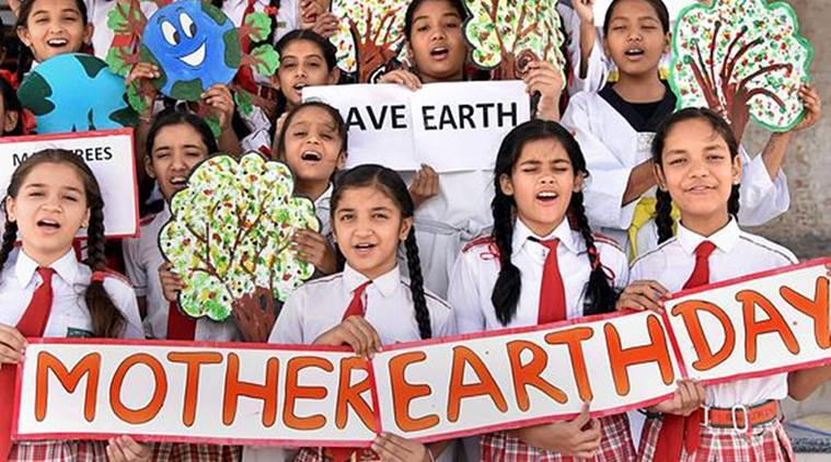 Bikaner: School children display banners and placards with social messages for saving the environment on the eve of 'World Earth Day' in Bikaner on Saturday. (PTI)