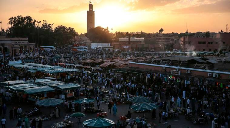 People gather in the landmark Jemaa el-Fnaa square, in Marrakesh, Morocco.