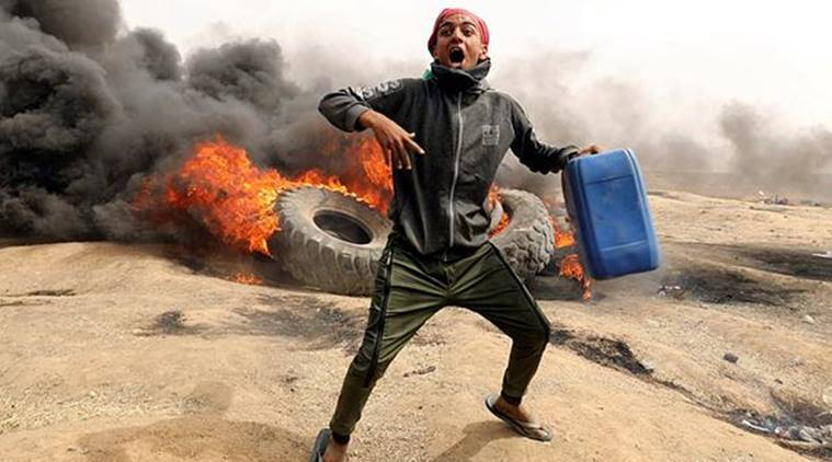 A demonstrator shouts during clashes with Israeli troops at a protest at the Israel-Gaza border where Palestinians demand the right to return to their homeland, east of Gaza City. (Reuters)