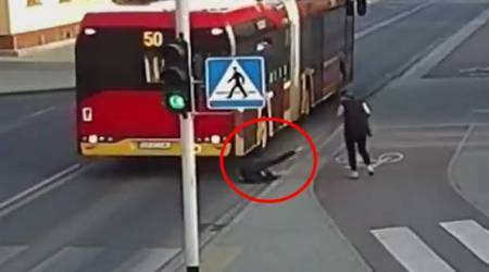 CCTV Video: SHOCKING moment when bus misses GIRL's HEAD by inches when PRANK goes wrong