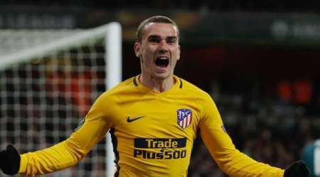 Antoine Griezmann celebrates after scoring against Arsenal at the Emirates