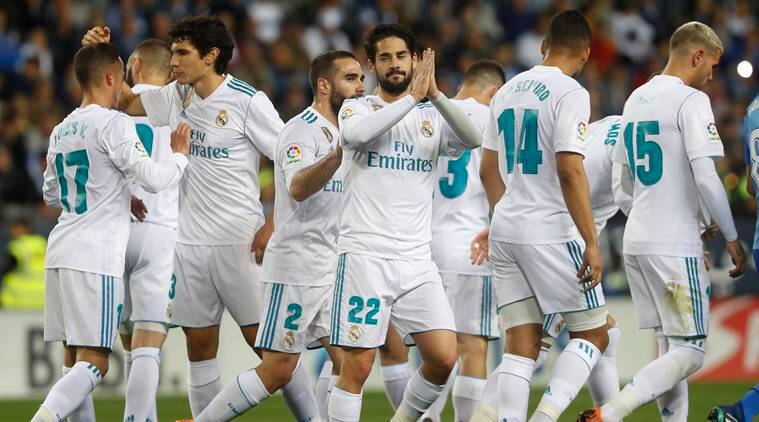 Real Madrid player Isco gestures after scoring against Malaga