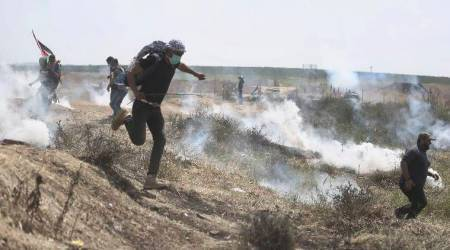 Israeli troops kill two Palestinians trying to cross from Gaza , saysarmy