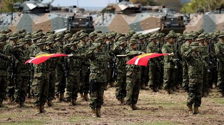 Soldiers of Japanese Ground Self-Defense Force (JGSDF)'s Amphibious Rapid Deployment Brigade, Japan's first marine unit since World War Two, attend a ceremony activating the brigade at JGSDF's Camp Ainoura in Sasebo, on the southwest island of Kyushu, Japan on Saturday. (Reuters)