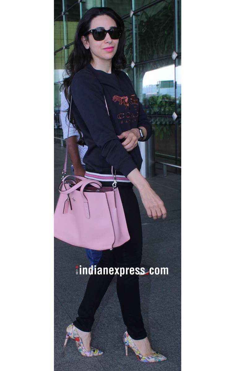 Airport style, Katrina Kaif fashion, Katrina Kaif latest photos, Katrina Kaif airport style, Karan Johar fashion, Karan Johar style, Karan Johar airport bags, Karisma Kapoor fashion, Karisma Kapoor latest photos, Karisma Kapoor airport style, Esha Gupta latest photos, Esha Gupta fashion, indian express, indian express news