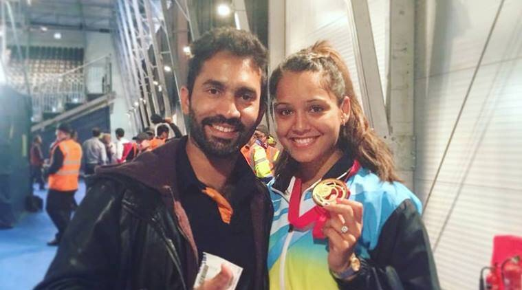 Dinesh Karthik and wife Dipika Pallikal pose at an airport