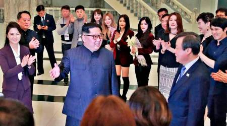 Cheeks flushed, hands clapping – how N Korea's Kim Jong Un enjoyed rare pop concert with wife